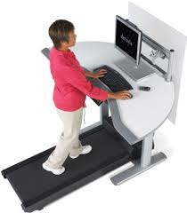 Walking a working with a treadmill fitness desk.